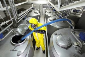 Chemical manufacturer evaluating chemicals.