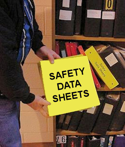 Person holding a binder with safety data sheets in it.