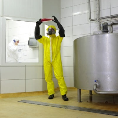 Employee inspecting a chemical sample.